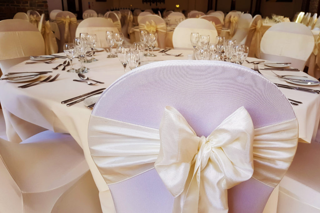 Chair covers with ivory sash